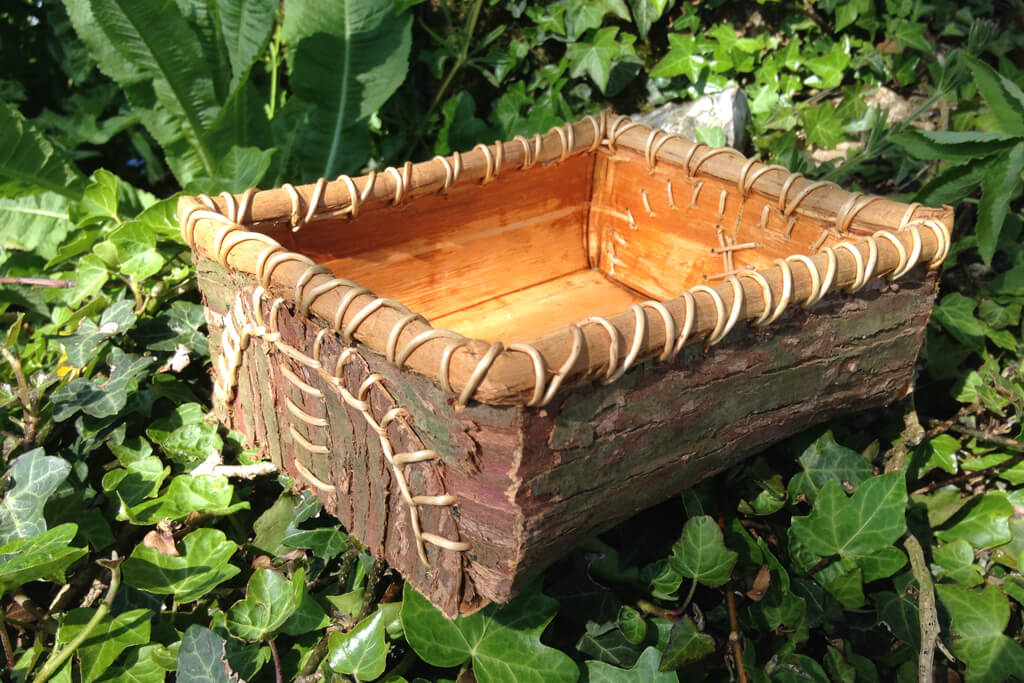Folded and stitched rectangular basket in red cedar bark and roots