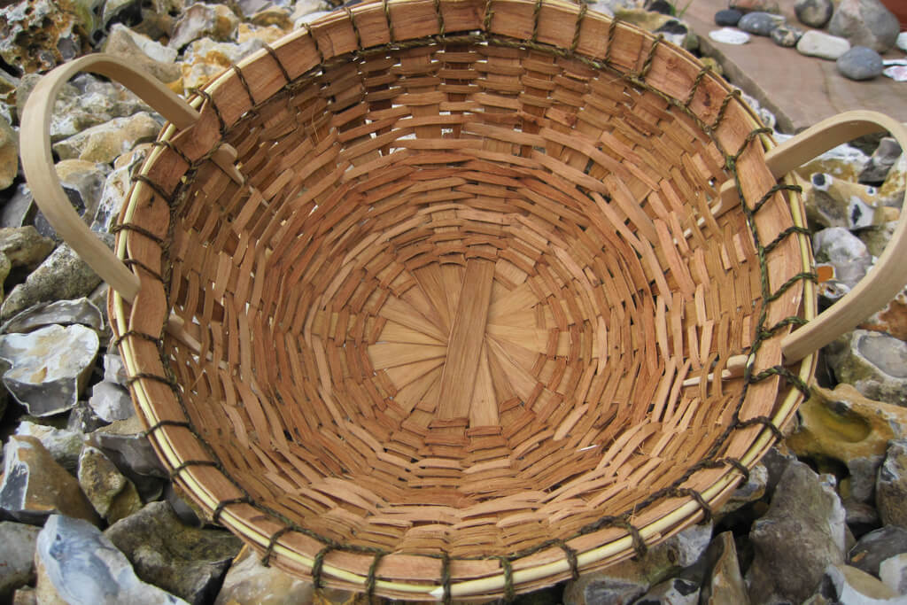 Gathering basket in sweet chestnut bark, ash handles and nettle cordage