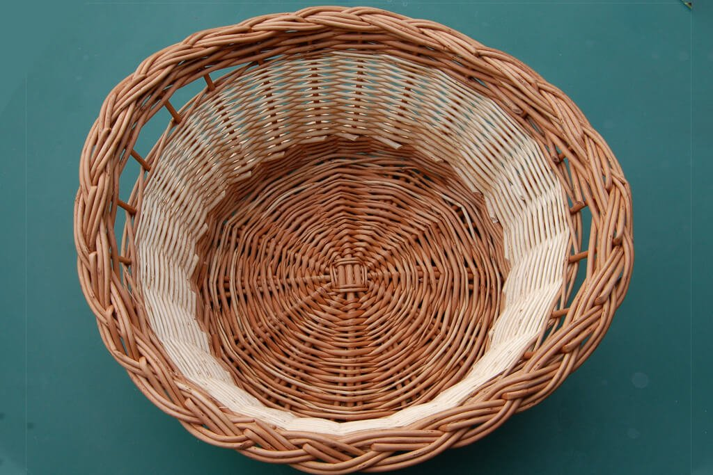 Willow basket with finger handles and plaited border in buff and white willow